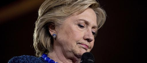 Clinton works to put out latest email fire