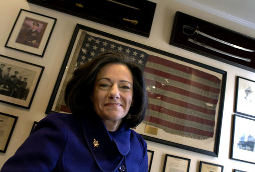"""FILE - In this march 6, 2006 file photo, Kathleen """"KT"""" McFarland is seen at her home in New York. President-elect Donald Trump has tapped Fox News analyst McFarland to serve as deputy national security adviser. (AP Photo/Jason DeCrow, File)"""