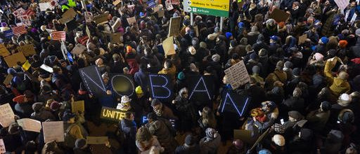 Protests erupt over travel ban