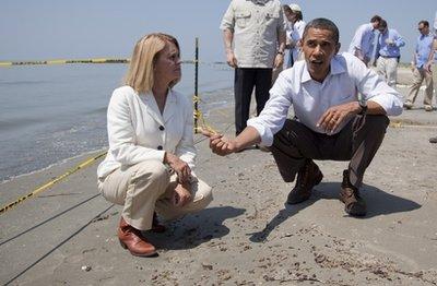 President Barack Obama and LaFourche Parish President Charlotte Randolph hunt for tarballs (AP)