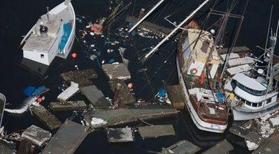 Tsunami surge devastates struggling California town
