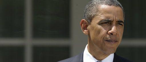 Obama's debt-deal signature averts default
