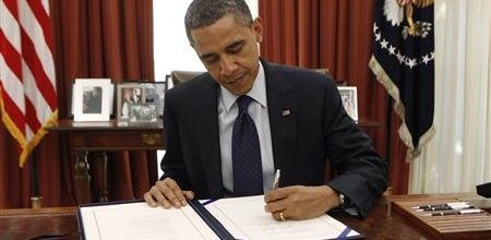 Congress passes two-month tax deal; Obama signs it into law