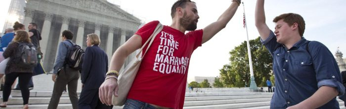 Gay rights supporters and gay couples salute Supreme Court ruling
