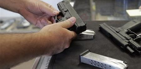 Illinois expands background checks on all gun purchases