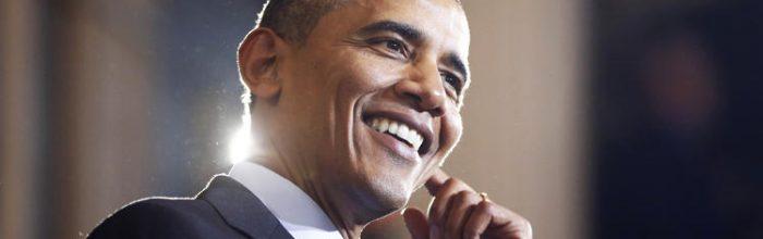 Obama signs bills raising debt limit, restoring vet benefits